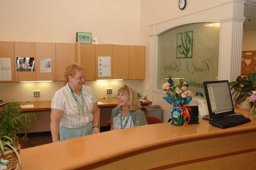 women at receptionist desk