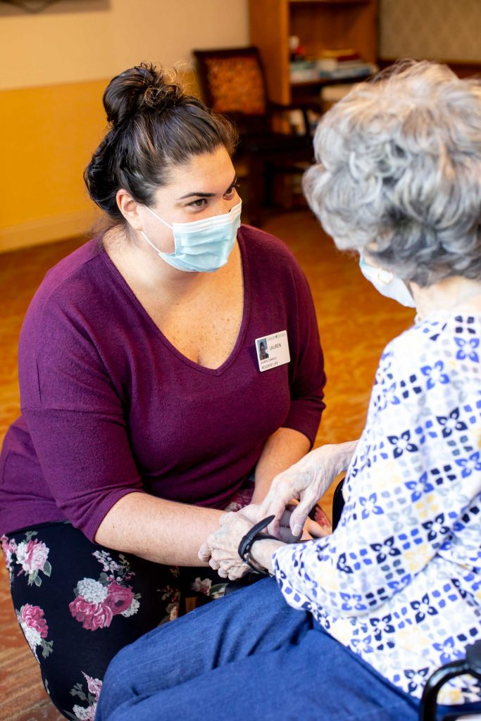 A staff member caring for a resident