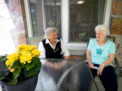 Residents chatting on the patio
